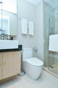 toilet in a very clean bathroom