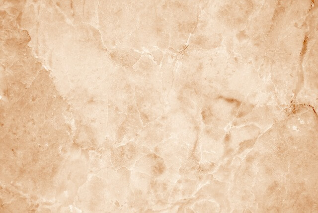 close up of travertine countertop, with an orange hue