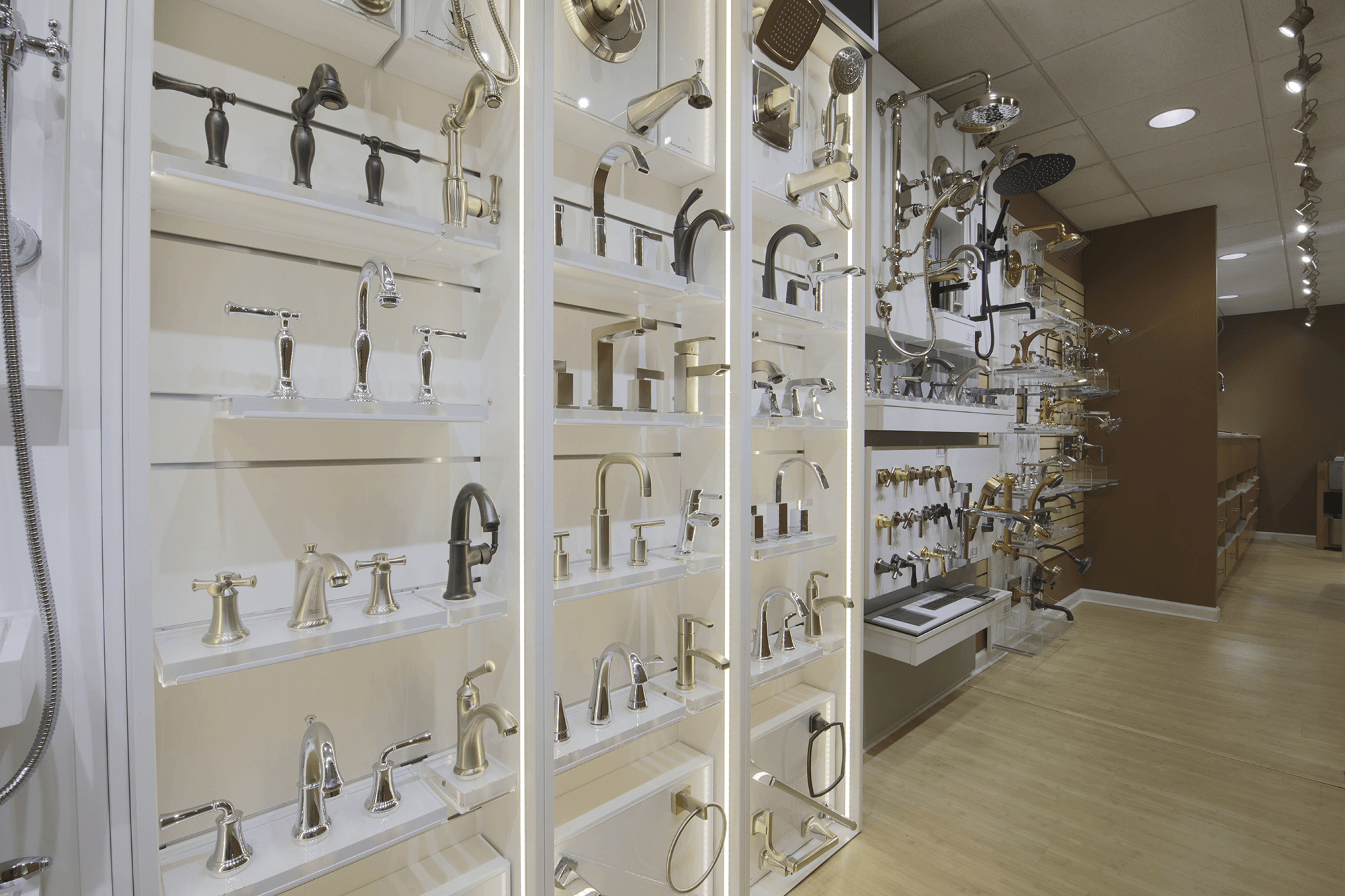 white display wall with multiple sections of various bathroom faucets