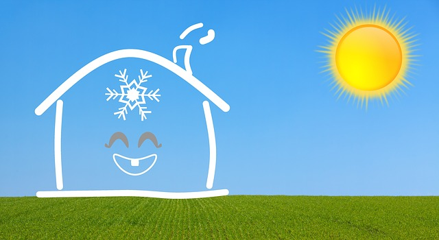 cartoon house with a one-tooth smile and a snowflake on its forehead emitting smoke through a chimney into a blue sky with the bright sun shining on raked green grass