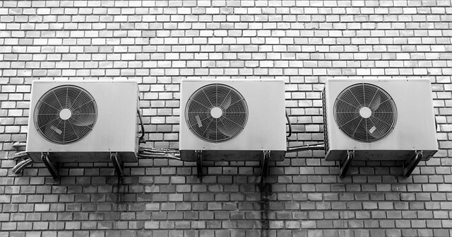 3 air conditioners mounted to the wall side by side