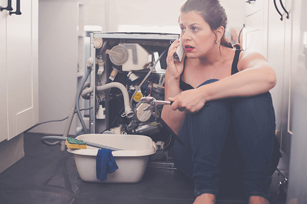 woman on the phone, distraught over her newfound plumbing problem, looking for plumbing advice